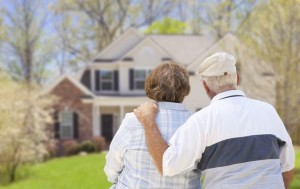 senior-couple-looking-at-their-home-792x500
